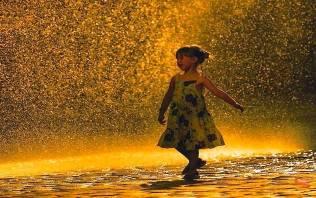girl in rain shower image